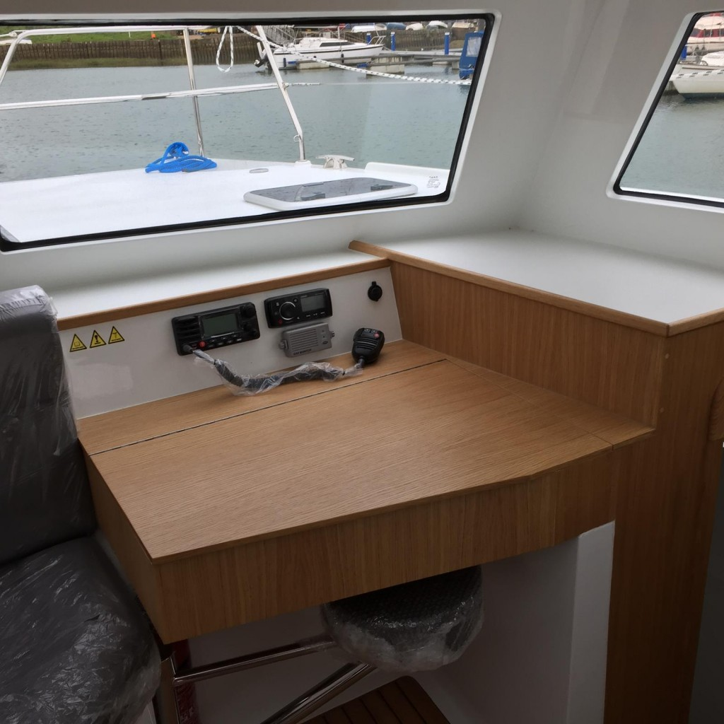Chart table beside inside helm position
